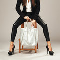 Beautiful woman with a silver fashion bag Royalty Free Stock Photo