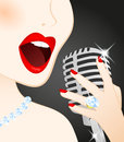 Beautiful woman singing in microphone Royalty Free Stock Photos