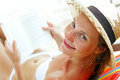 Beautiful woman sitting on beach reading a book Royalty Free Stock Images