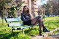 Beautiful woman sitting bench city park Royalty Free Stock Photography