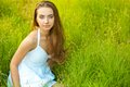 Beautiful woman sitting in the grass Stock Photography
