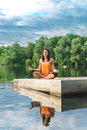 Beautiful woman sitting in lotus pose Royalty Free Stock Photo