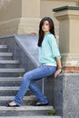 Beautiful woman sitting on the stairs Royalty Free Stock Photo