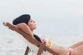 Beautiful woman sleeping on deck chair beach Royalty Free Stock Photos