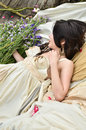 Beautiful woman sleeping with flowers outdoor Royalty Free Stock Photography