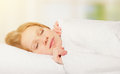 Beautiful woman sleeping in white bed net Royalty Free Stock Photo