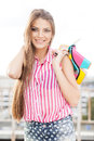 Beautiful woman in sleeveless striped top holding bright high he Stock Photography