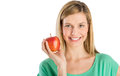 Beautiful woman smiling while holding apple portrait of young against white background Royalty Free Stock Photos