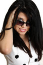 Beautiful woman smiling looking over sunglasses young brunette and her she has thick long black hair feeling fabulous fashion Stock Images