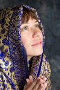 Beautiful woman smiling with shawl praying Stock Photography