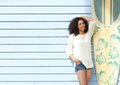 Beautiful woman smiling in summer portrait of a young african american enjoying outdoors Royalty Free Stock Photo