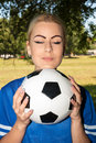 Beautiful woman with soccer ball portrait of Stock Image