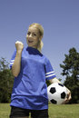 Beautiful woman with soccer ball portrait of Stock Images