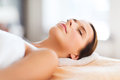 Beautiful woman in spa salon beauty and concept lying on the massage desk Stock Photo