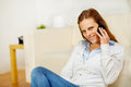 Beautiful woman speaking on cellphone at home Royalty Free Stock Photo