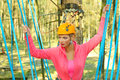 Beautiful woman in a special outfit climbing the trees Stock Photos