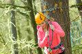 Beautiful woman in a special outfit climbing the trees Royalty Free Stock Image