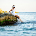 Beautiful woman splashing in the sea Royalty Free Stock Photo