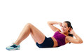 Beautiful woman in sportswear does exercises lying on floor Royalty Free Stock Photography
