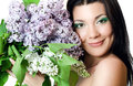 Beautiful woman with spring flowers of a lilac Royalty Free Stock Image