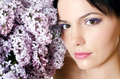 Beautiful woman with spring flowers of a lilac Royalty Free Stock Photos