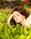 Beautiful woman in spring green lilies Stock Photo