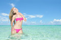 Beautiful woman stand in the tropical sea Stock Photos
