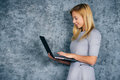 Beautiful woman standing with laptop computer Royalty Free Stock Photo