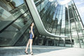 Beautiful  woman standing near the building of the business center. Royalty Free Stock Photo