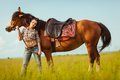 Beautiful woman standing near a horse young Stock Photography