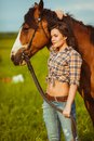 Beautiful woman standing near a horse young vertical photography Stock Photo