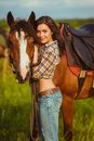 Beautiful woman standing near a horse young vertical photography Stock Images