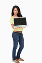 Beautiful woman student showing a laptop screen Royalty Free Stock Photos