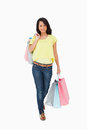 Beautiful woman student walking with shopping bags Stock Images