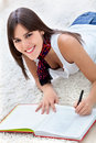 Beautiful woman studying Stock Images