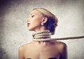 Beautiful woman suffering with a rope around her neck Stock Photos
