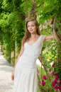Beautiful woman in summer park white dress among the plants flower Stock Photo