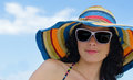 Beautiful woman in a summer sunhat with colourful stripes wearing sunglasses Stock Photos