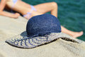 Beautiful woman in summer vacation, lying down and sunbathing. Female straw hat, selective focus image