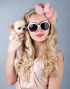 Beautiful woman in sun glasses and small chihuahua in hands smiling Stock Photo