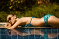 Beautiful woman sunbathing near swimming pool Royalty Free Stock Photos