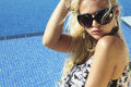 Beautiful woman in sunglasses summer girl near the swimming pool blond Royalty Free Stock Image