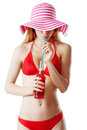 Beautiful woman with sunhat is having a drink dringk isolated on white Royalty Free Stock Photo