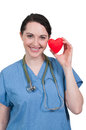 Beautiful woman surgeon young cardiology holding a heart Royalty Free Stock Photo