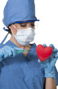 Beautiful woman surgeon young cardiology performing surgery Royalty Free Stock Images