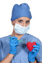 Beautiful woman surgeon young cardiology performing surgery Royalty Free Stock Photography