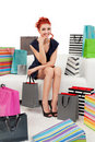 Beautiful woman surrounded with bags Royalty Free Stock Images