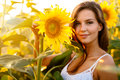 Beautiful woman surrounded by sunflowers Royalty Free Stock Photo