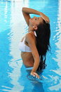Beautiful woman in a swimming pool Royalty Free Stock Photo