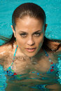 Beautiful woman in a swimming pool. Stock Photo